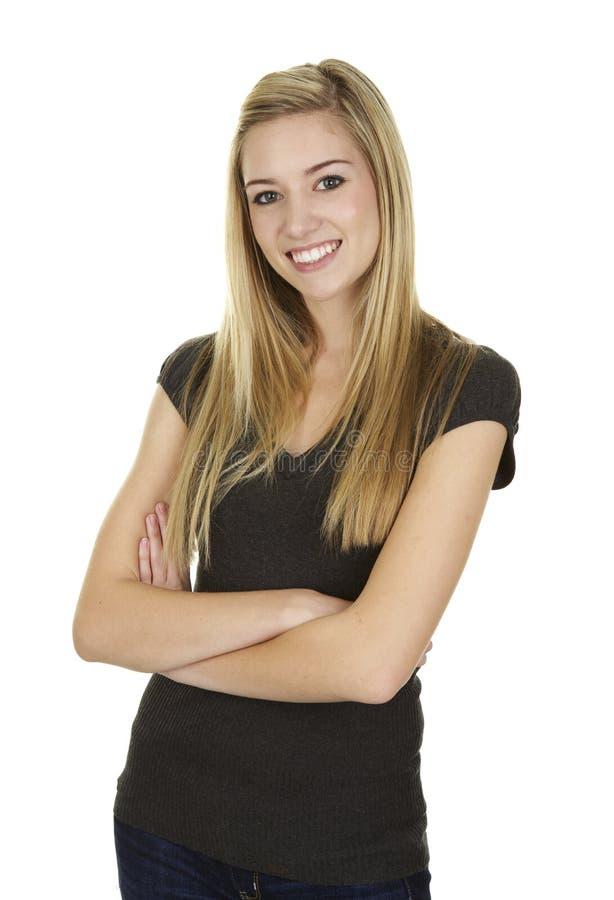 Säker ung blond kvinna på vit bakgrund arkivbilder