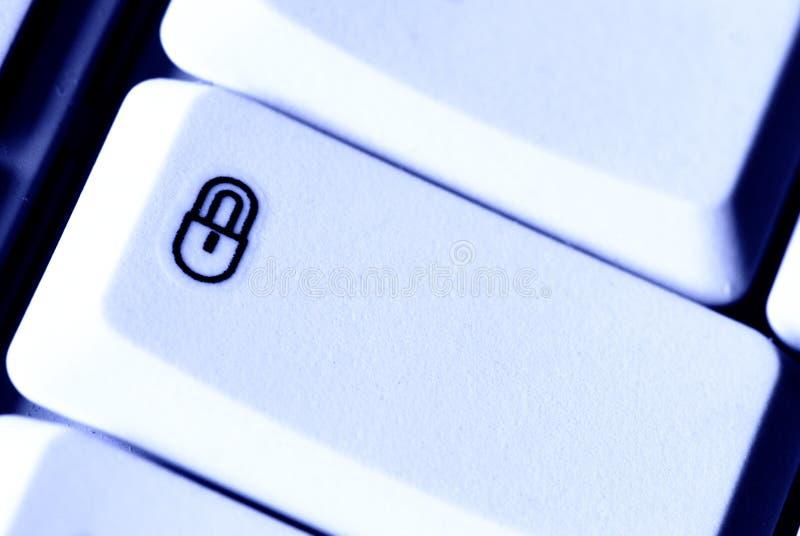 säkerhet för knappdatorlås royaltyfri foto