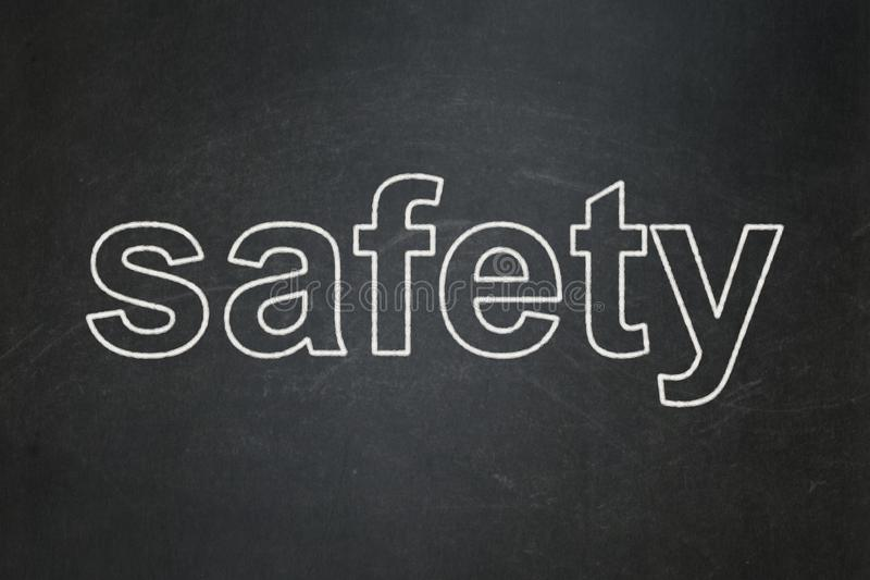 Säkerhetsbegrepp: Säkerhet på svart tavlabakgrund royaltyfria foton