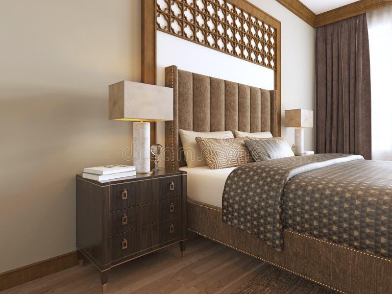 Säng i det mellersta - östlig stil med träsned arabiska textiler för huvudgavel och för säng royaltyfri illustrationer