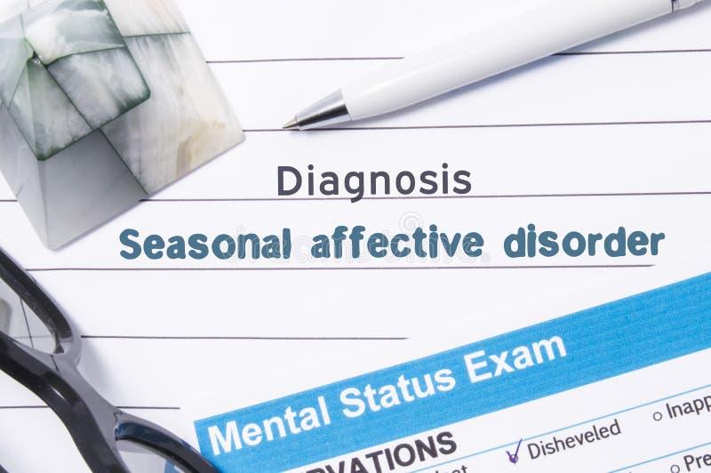 Säsongsbetonad Affective oordning för psykiatrisk diagnos Den medicinska boken eller formen med namn av säsongsbetonad Affective  royaltyfria bilder