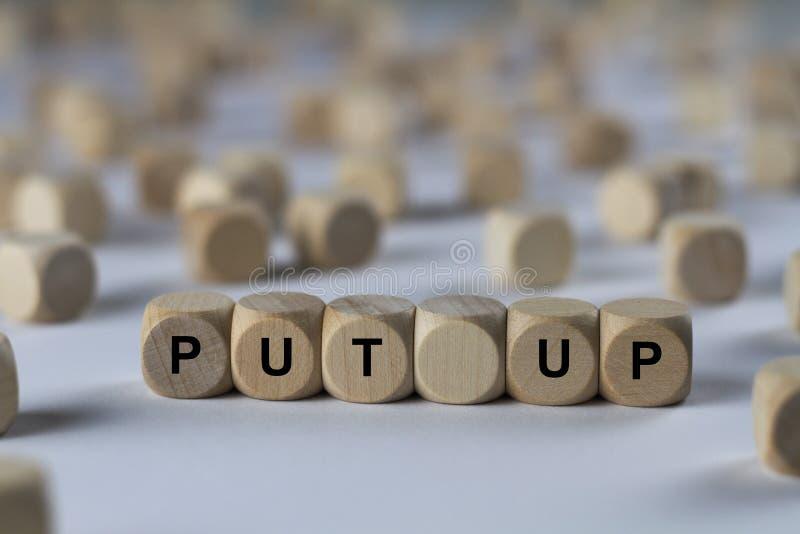 Sätt upp - kuben med bokstäver, tecken med träkuber fotografering för bildbyråer