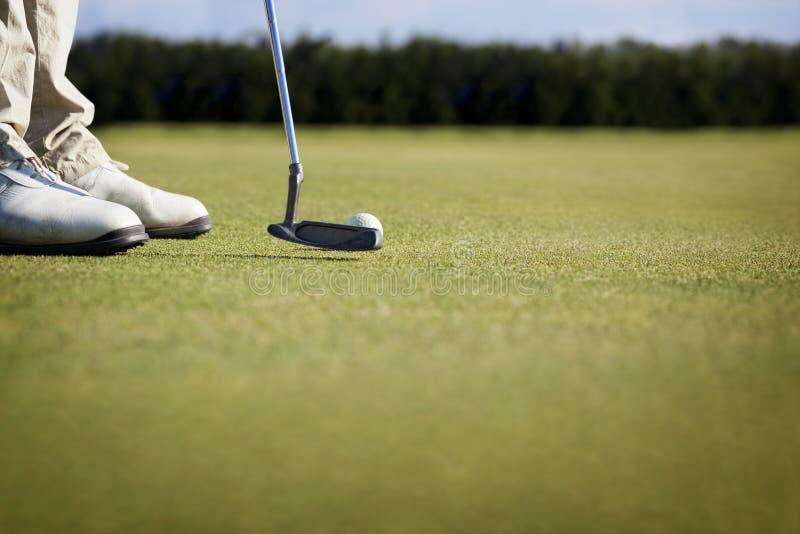 sätta för golfaremakro royaltyfri foto