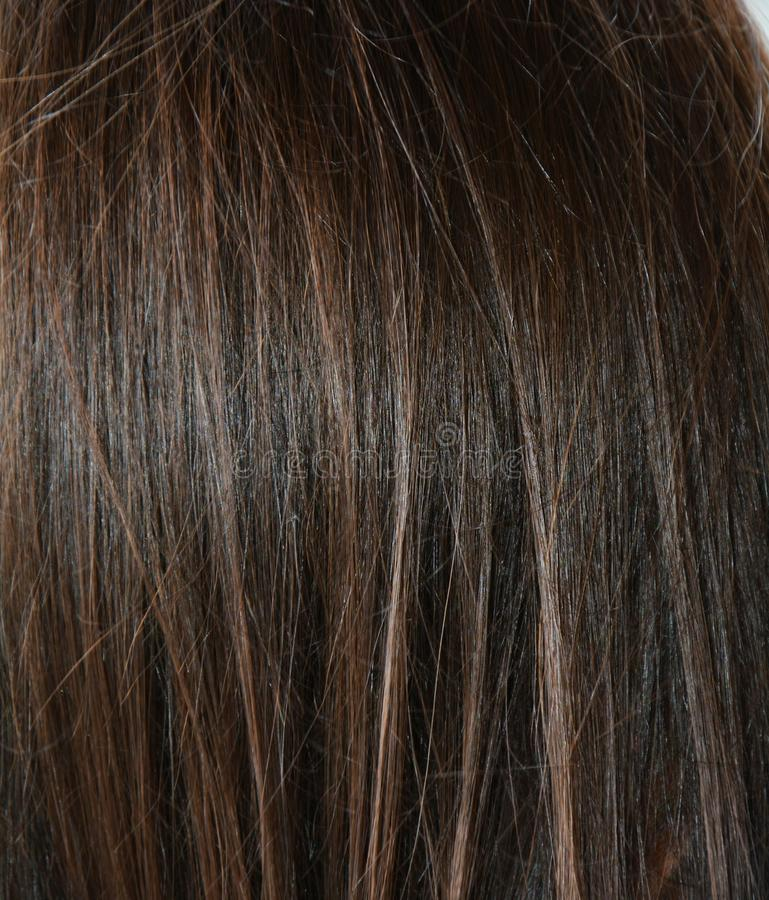 Säubern Sie Hintergrund des dunklen Haares lizenzfreies stockbild