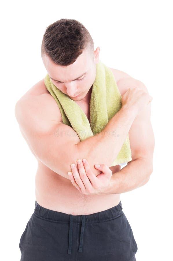 Sårad armbåge för kondition- eller bodybuildinginstruktör innehav arkivfoton