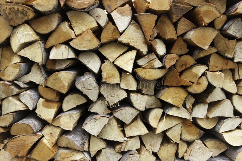 Séchez la texture coupée de backround de rondins de bois de chauffage images libres de droits