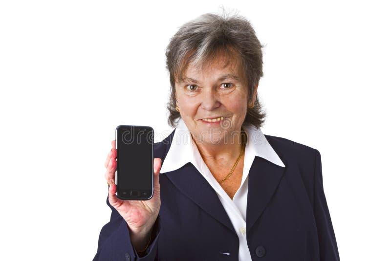 Sénior fêmea bem sucedido com telemóvel fotografia de stock royalty free