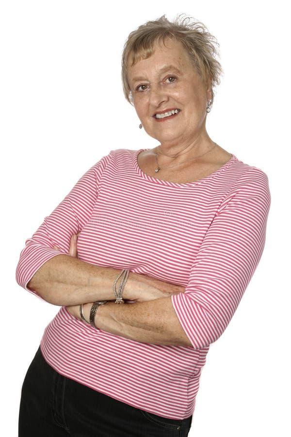 sénior fêmea caucasiano na parte superior cor-de-rosa imagens de stock royalty free