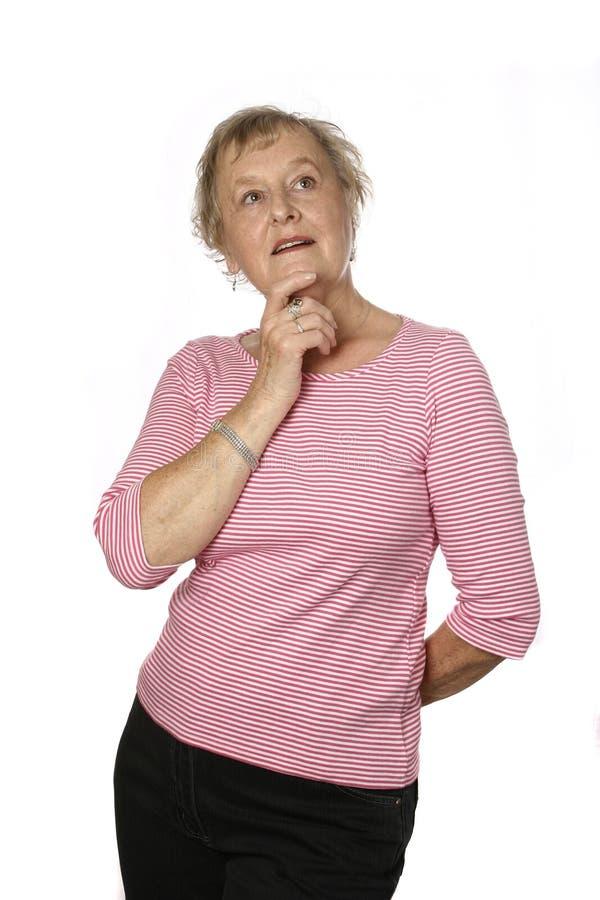 Sénior fêmea caucasiano na parte superior cor-de-rosa imagem de stock royalty free
