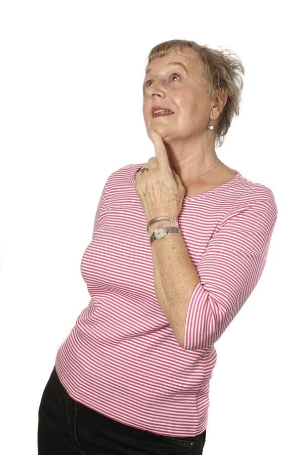 Sénior fêmea caucasiano na parte superior cor-de-rosa fotos de stock royalty free