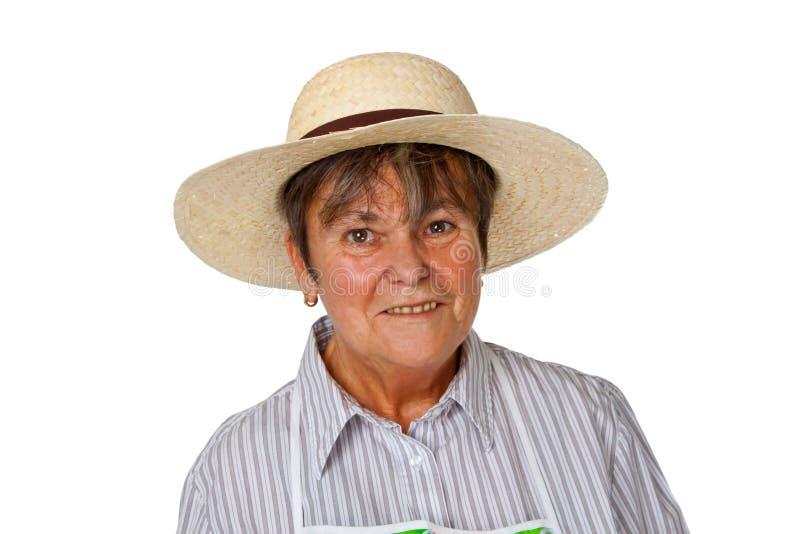 Sénior fêmea com chapéu de palha imagens de stock