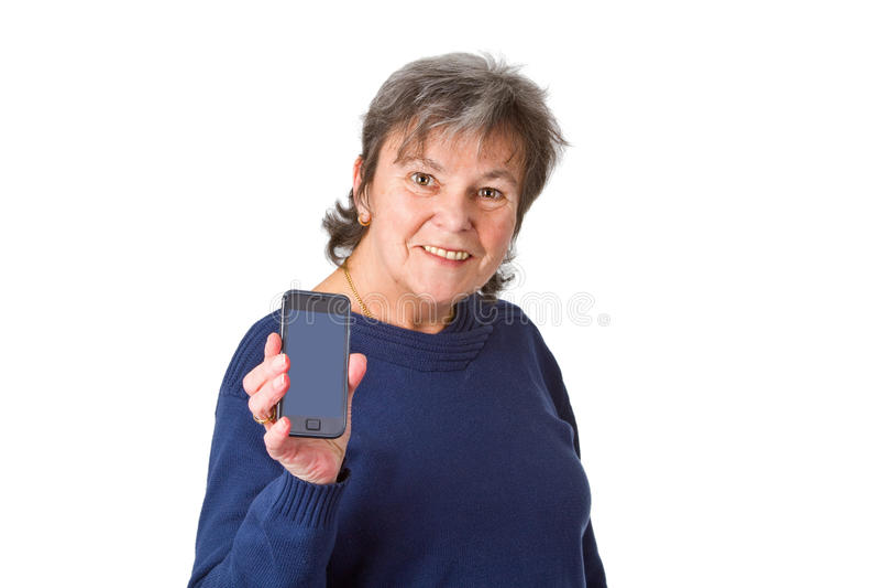 Sénior fêmea com seu smartphone imagens de stock royalty free