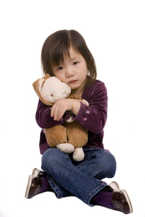 Série 4 d'enfance (pleurant avec le lapin) photos stock