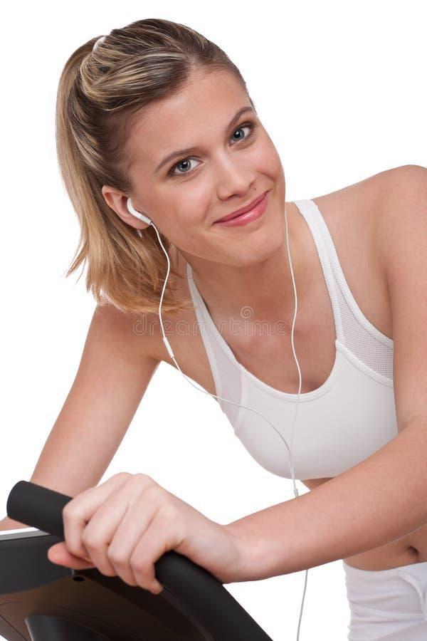 Série de forme physique - femme avec l'exercice d'écouteurs photos libres de droits