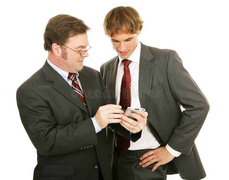 Série do mentor - homens de negócios imagens de stock