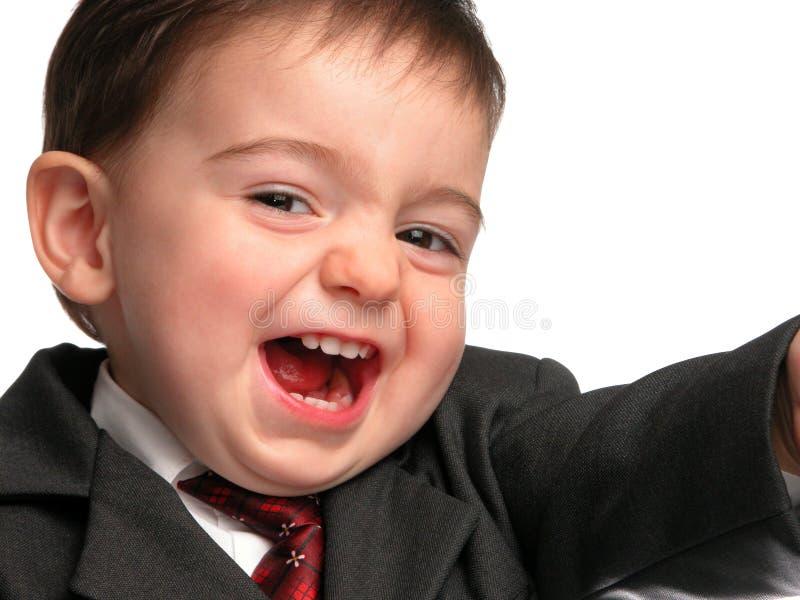 Série pequena do homem: Sorriso do vendedor fotografia de stock royalty free