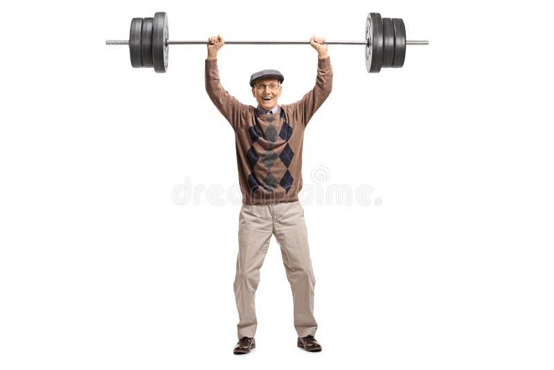 Sênior alegre com um barbell foto de stock