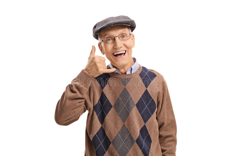 Sênior alegre que faz a uma chamada me gesto imagem de stock