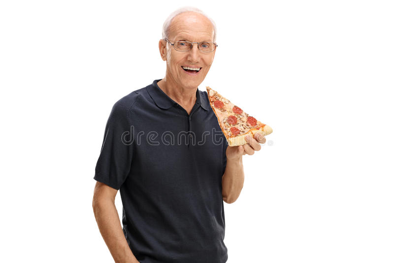 Sênior alegre que tem uma fatia de pizza fotos de stock