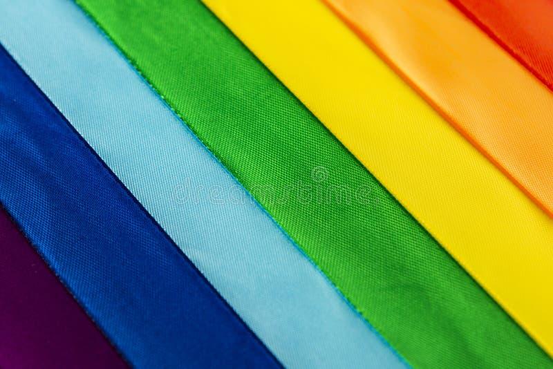 Símbolo da bandeira de LGBT feito de fitas do cetim imagens de stock royalty free