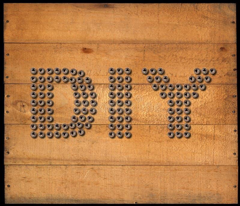Símbolo de Diy - parafusos no fundo de madeira ilustração stock