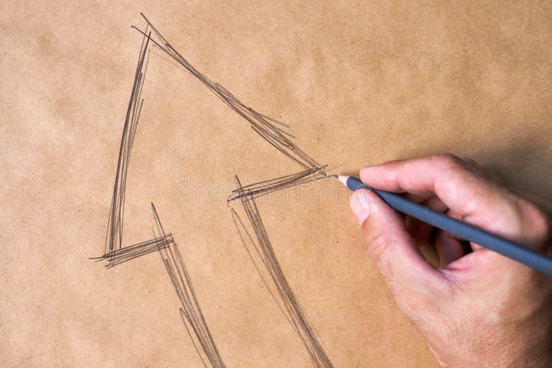 Símbolo de la flecha de la mano que bosqueja en el papel imagen de archivo libre de regalías