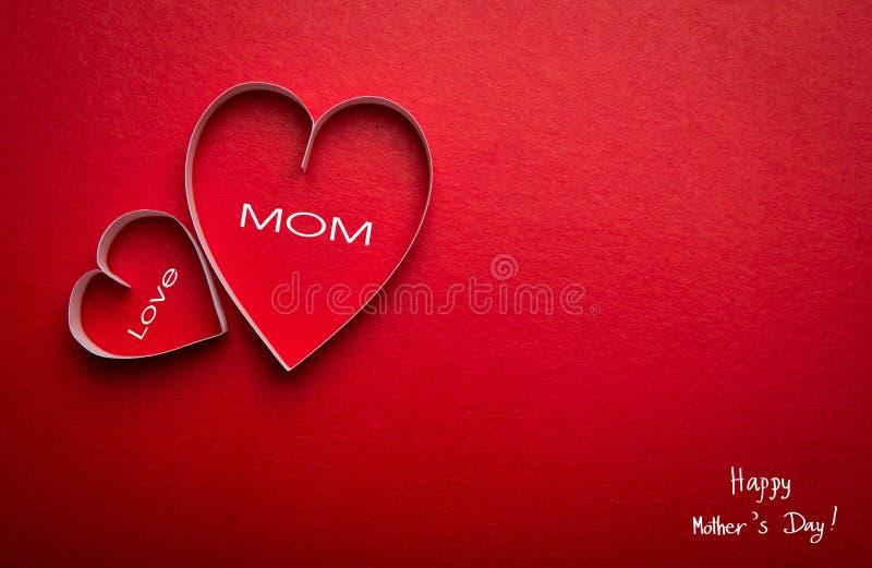 Símbolo de papel de la forma del corazón para el día de madres foto de archivo