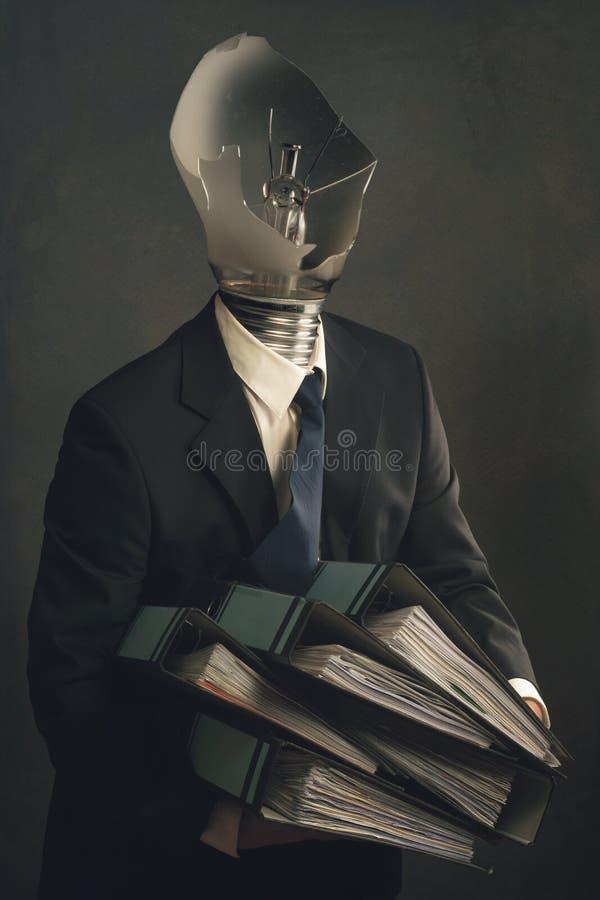 Símbolo de un hombre de negocios con síndrome de la quemadura imagen de archivo libre de regalías