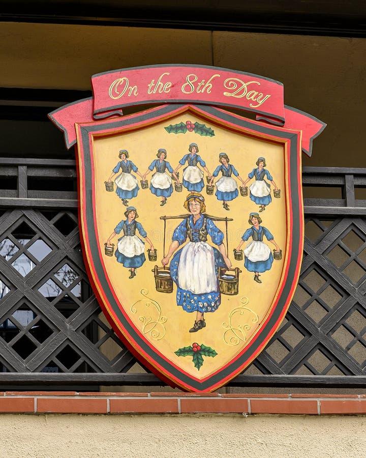 Símbolo do oitavo dia do famoso 'Os Doze Dias do Natal', uma canção com doze versos cada descrevendo um presente dado imagem de stock