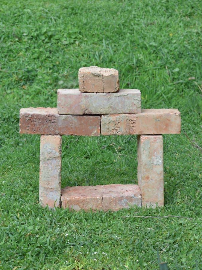 Símbolo do tijolo de uma casa nova foto de stock