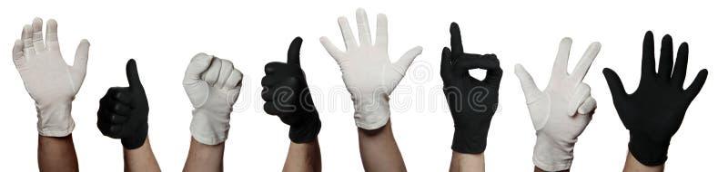 Símbolo dos trabalhos de equipa com luvas preto e branco foto de stock royalty free