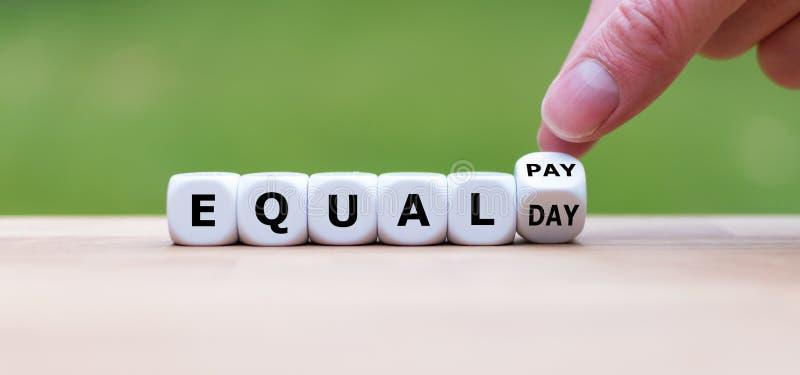 Símbolo para el día de la igualdad de salario fotografía de archivo