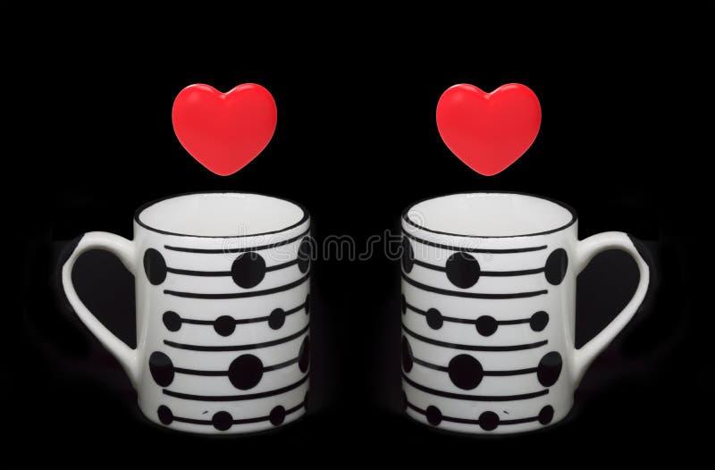 Símbolos e copos do coração foto de stock