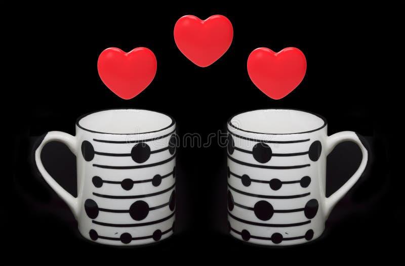 Símbolos e copos do coração fotografia de stock royalty free