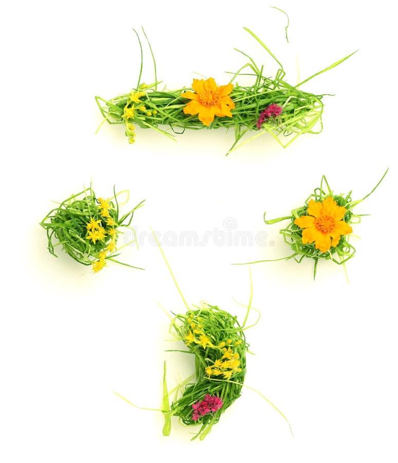 Símbolos feitos das flores e da grama imagens de stock