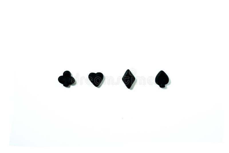 Símbolos pretos dos cartões de jogo contra o fundo branco fotografia de stock royalty free