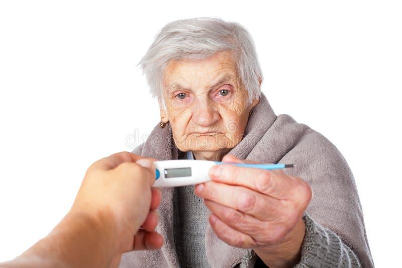 Síntomas de la gripe en ancianos fotos de archivo