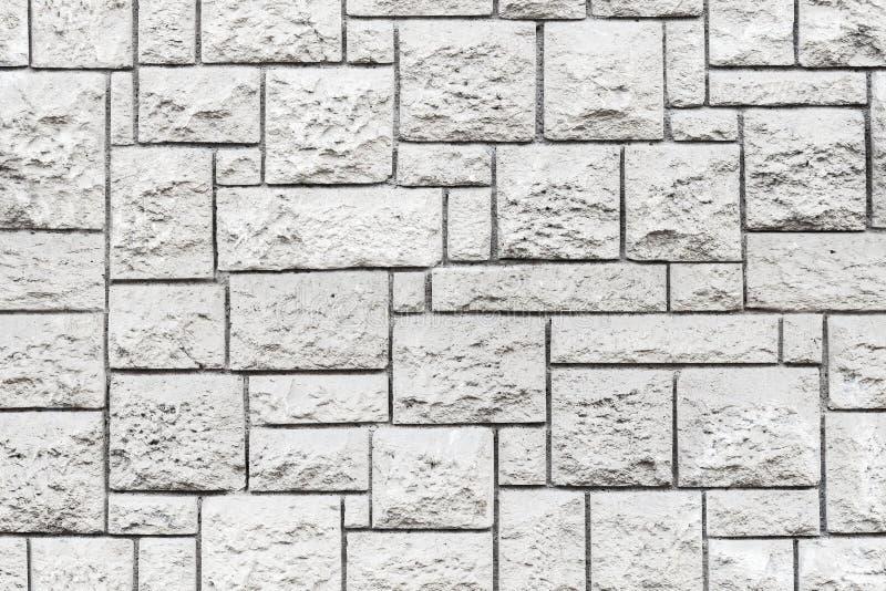 Sömlös bakgrundstextur av den gråa stenväggen royaltyfria foton