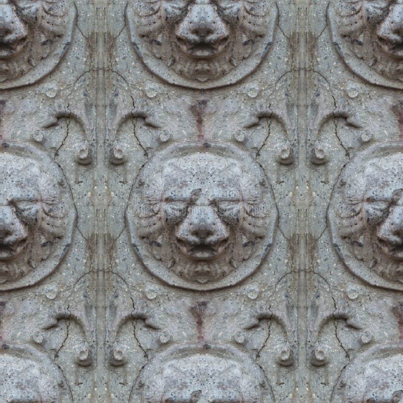 Sömlös fototextur av huvudet för antikvitetstenlejon från den brutna slottväggen royaltyfria bilder