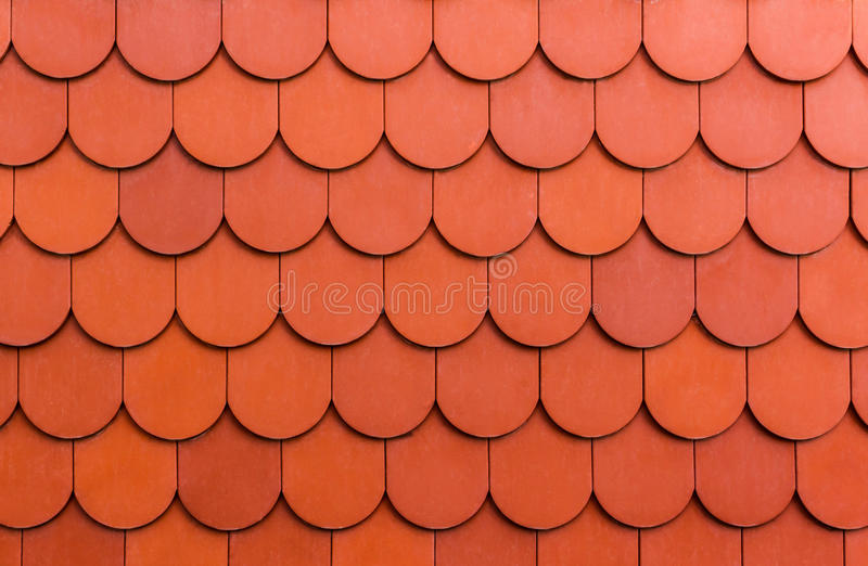 Sömlös orange bakgrund för textur för taktegelplatta. royaltyfria foton