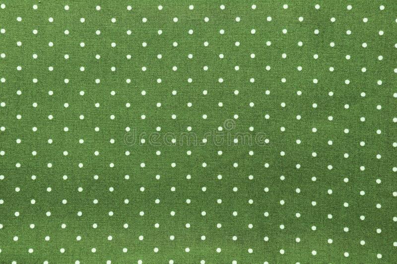 Sömlös prickmodell på grönt tyg arkivbilder