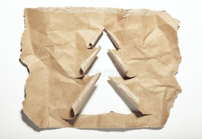 Sönderriven pappers- julgran arkivfoton