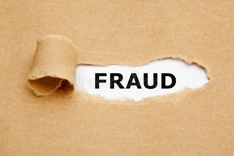 Sönderrivet pappers- begrepp för bedrägeri arkivfoto