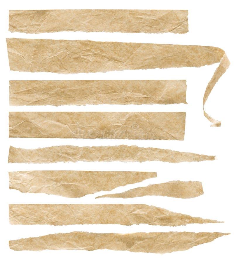 Sönderrivna gamla skrynkliga pappersstycken, riven sönder uppsättning för bandbuseetiketter royaltyfri bild