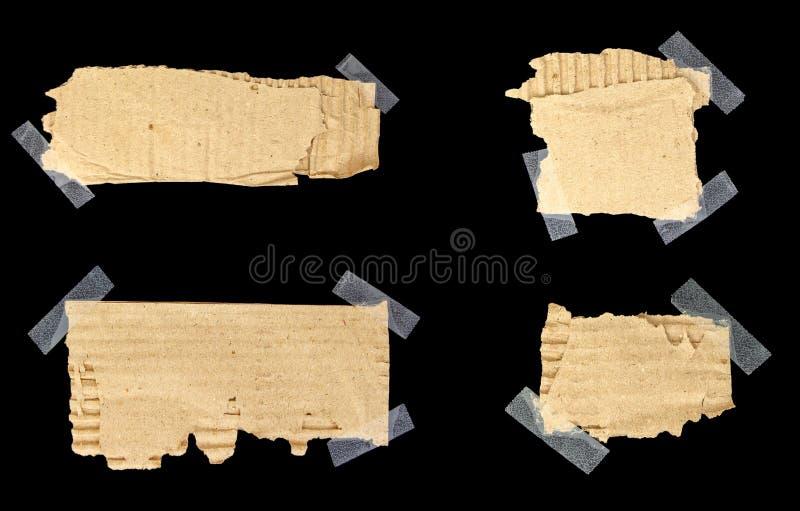 Sönderrivna papprester klibbade med tejpen med kopia-utrymme arkivfoto