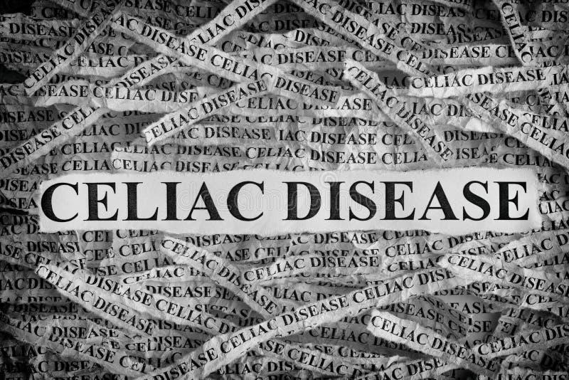 Sönderrivna stycken av papper med den Celiac sjukdomen för ord arkivbilder