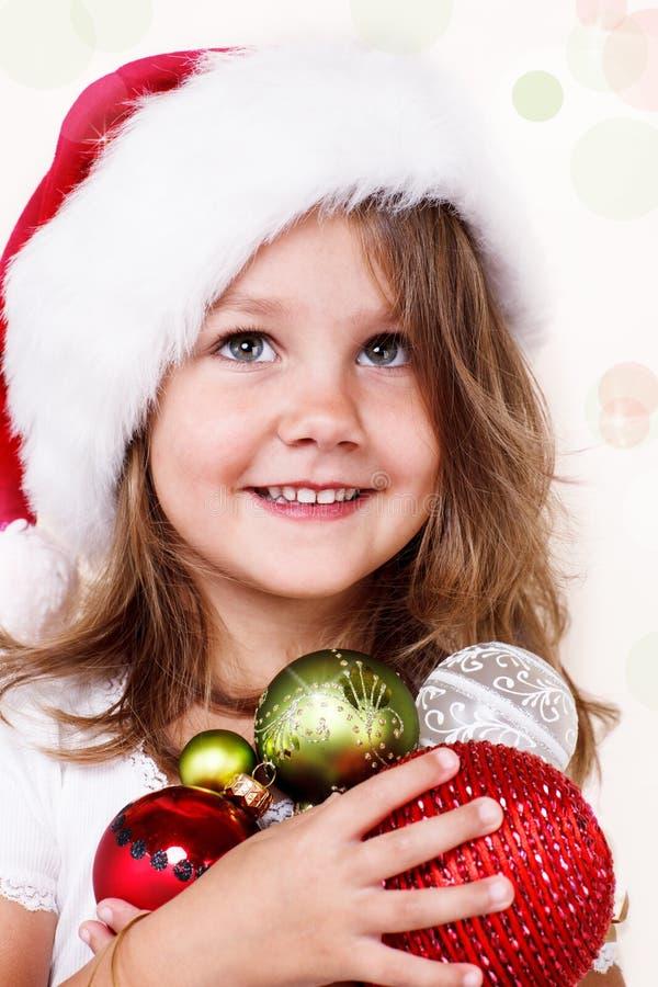 Söt flicka i den Santa hatten royaltyfri fotografi