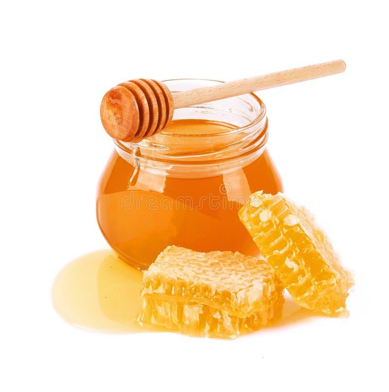 Söt honung och honungskaka royaltyfri foto