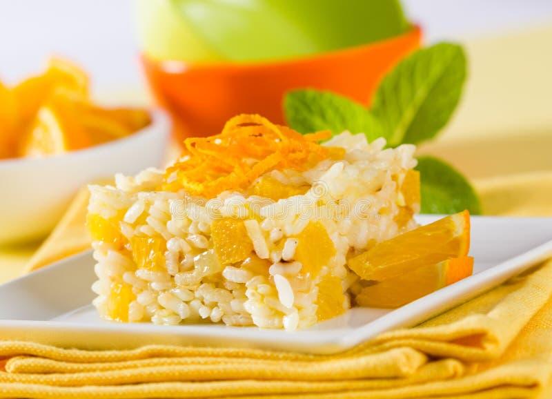 Söta ris med apelsinen arkivfoto