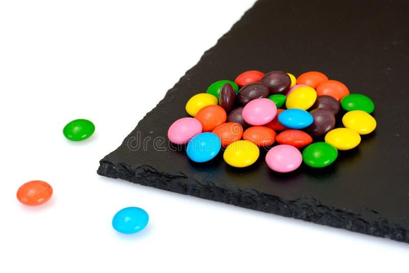 Süße Bonbon-Süßigkeit auf lokalisiert stockbilder